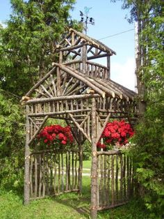 Arbor made from discarded branches .It is 7 ft square x 14 ft tall. By fine gardening Garden Arbor, Garden Trellis, Garden Gates, Rustic Gardens, Outdoor Gardens, Veggie Gardens, Outdoor Projects, Garden Projects, Log Projects