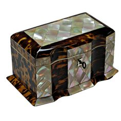 Exceptional Tortoise and Mother of Pearl Tea Caddy, C1810, of rectangular form with skirted base; the hinged lid with Mother of Pearl and ivory inlay, the front also decorated with mother of pearl with two covered compartments and silver escutcheon, supported by bun feet, with working key and lock.