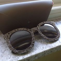 Pewter Gray Lace Filgeree Cutout Sunglasses Brand New Pair of Pewter Gray Sunglasses with lace cutout design frames. Comes with case and cleaning cloth. Accessories Sunglasses