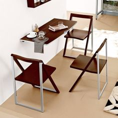 awesome dining room design with mounting teak table and ergonomic folded chairs beside black white area rug
