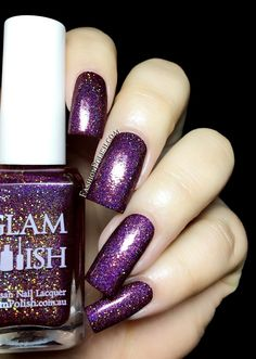 Dreamgirls is a pink based purple holo with a mix of gold shimmer, gold hologrphic micro glitters and red sparkles.