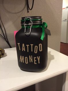 Spray painted jar I made for my boyfriends tattoo money :)