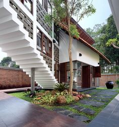 This modern Indonesian house designed by architecture firm TWS & Partners is a beautiful balance of nature and man-made, indoors and outdoors, public and private spaces. Surrounded by lush, tropical. Modern Tropical House, Tropical House Design, Tropical Houses, Minimalist House Design, Minimalist Home, Tropical Architecture, Architecture Design, Indonesian House, Exterior Design