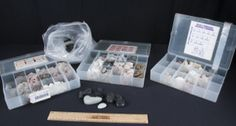 FOR THE ULTIMATE ROCK COLLECTOR, THIS LOT FEATURES THREE BOXED COLLECTIONS THAT INCLUDES CALCITE, GRAPHITE, LIMESTONE, MARBLE, OBSIDIAN, SANDSTONE, AND SO MUCH MORE. ALSO INCLUDED IS A BAG OF BLACK DECORATIVE AND STONE PEBBLES.