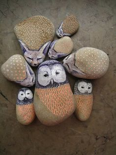 painted stones with owls and foxes