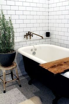 clawfoot tub, subway tile, spigot, stool - pretty much everything