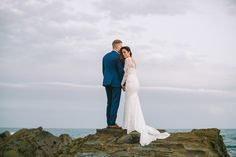 A long-sleeved Mariana Hardwick wedding gown and the groom in blue suit   I Take You #elope #elopement #marianahardwick