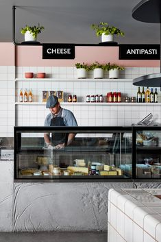 A counter that looks like sliced salami and light fixtures that recall strings of bocconcini balls feature in the Hunter & Co Deli by Mim Design. Meat Restaurant, Restaurant Seating, Luxury Restaurant, Modern Restaurant, Mim Design, Meat Shop, Meat Platter, Cafe Interior Design, Interior Shop