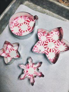 Peppermint Candy Christmas OrnamentsThese edible ornaments are so simple and thrifty. You could make a dozen ornaments at just a dollar per bag of peppermints! Use this method to create home decor or use these candies for edible decorating… one peppermint, melted in a tiny cookie cutter, would make a cute cupcake topper!