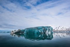 Black Ice  This is how I'm fighting the heatwave, it's crazy hot in southern Ontario this week  This blue/black ice is the largest iceberg of this type of ice I have ever seen Ice of this type is really dense and only transmits light from that aqua blue and blue black wavelength  #ice #iceberg #blackice #arctic #svalbard #reflections #mirror #glassy  www.ronclifford.com