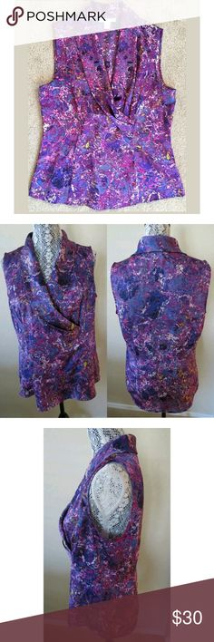 """NWOT Coldwater Creek Purple Silky Shawl Collar Top So many flattering aspects! Gorgeous print in Spring-ready watercolors on a striking purple background. Lovely pleated collar & side ruched neckline creates the illusion of a wrap style. Material feels silky soft. Makes a beautiful shell under a blazer for the office or wears well alone with jeans & heels for a classy night out.   Never been worn but the tags were taken off.   {Materials} 100% Polyester  {Measurements} Bust: 17.5"""" Length…"""