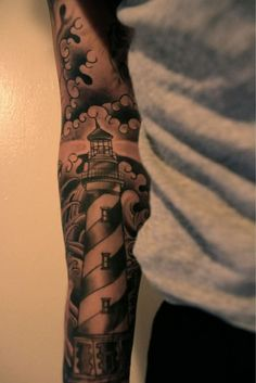 Beautiful Grey Ink Lighthouse Tattoo On Arm Sleeve