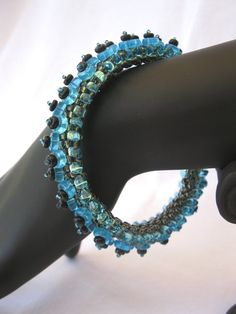 Beaded bangle with spikes and studs in aqua and by SimpleeDesigns, $30.00