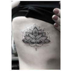 Wow. Lotus tattoo by Dr Woo on Ellie Goulding!