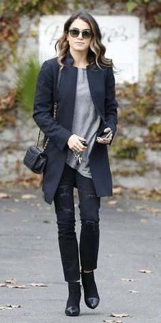 Nikki Reed polishes up destroyed jeans and tee outfit with a tailored jacket and quilted purse.