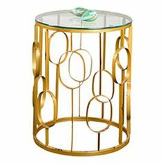 """Glass-topped side table with openwork metal base.      Product: Small and large side table Construction Material: Glass and metal   Color: Gold   Dimensions: Small: 20"""" H x 16"""" Diameter Large: 23"""" H x 19"""" Diameter"""