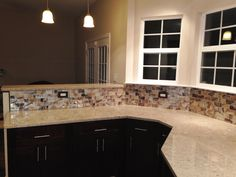 Kitchen Remodel by M.A.K. Construction Services- Craftsman Java Maple Wood Cabinets, Glass Tile Backsplash, Pendant Lights