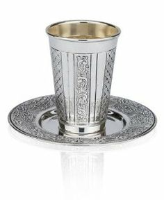 Sterling Silver Plated Kiddush Cup with Diamond Shapes and Floral Pattern by World of Judaica. $66.00. You will be pleasantly surprised! The vast majority of our shipments arrive within 10-14 business days from time of shipment, far in advance of Amazon's default calculation of shipping times for items shipped from Israel.. Your order includes 1 item(s).. Material: Silver Plated. Dimensions: 8.5cm. This sterling silver Kiddush Cup features sections engraved with floral patterns a...