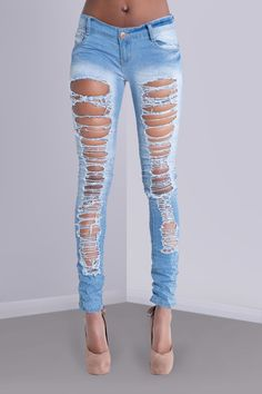 The perfect statement jeans for girls who love living life on the edge. These sexy low rise light denim jeans feature extreme distressed rips down all the way the front of the legs. Dare to wear these with some killer heels?  Please note this item is tight fitting, if you prefer a more relaxed style you may benefit buying a size larger