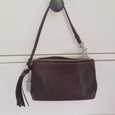 """Authentic Brown Coach Leather Wristlet Authentic Brown Coach Leather Wristlet. NWOT. Never used and in perfect condition. 8 1/2"""" x 4 1/2"""". Comfortably fits iPhone 5, your ID, some extra cash, and lip gloss! No paypal, trades, holds, or lowball offers. Thanks for looking and happy shopping! Coach Bags Clutches & Wristlets"""