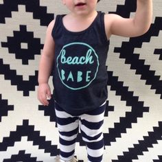***THIS IS THE PRE ORDER PAGE FOR THE BEACH BABE TANKS. YOU CAN CHOOSE 3 COLORS: BLACK, GREEN, OR PURPLE.********TANKS ONLY COME IN SIZES 2T,4T, 6T***********PLEASE NOTE THIS ARE A PRE ORDER AND CAN TAKE UP TO 3 WEEKS BEFORE SHIPPING OUT*********TANKS RUN SMALL*******PURPLE SHIRT IS ACTUALLY A LIGHTER SHADE OF PURPLE THAN SHOWN*****Our shirts have that wonderful, super soft, vintage feel that is perfect for your little babes.  They are printed on American Apparel...