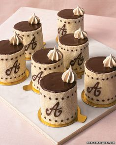 Calligraphy and Cakes  The monograms on these French patisserie-style charlottes, or molded sponge cakes, consist of piped chocolate batter baked into almond-flavored cake.