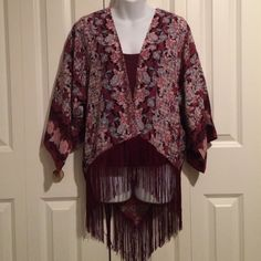 Reduced! Burgundy Patterned Fringe Hi Low Kimono So pretty and easy to wear! Deep burgundy with softer hues patterned in. Fringe all along bottom. Higher in front, lower in back. 3/4 drop sleeve. Sits at hip. More like a top, less like an oversized kimono. Rue 21 Tops
