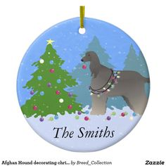Afghan Hound decorating christmas tree-forest Double-Sided Ceramic Round Christmas Ornament ❤  Find more Breed Collection here…. ❤ BreedCollection.com ❤ TriPodDog.Etsy.com ❤ TriPodDogDesign.RedBubble.com ❤ http://www.zazzle.com/breed_collection