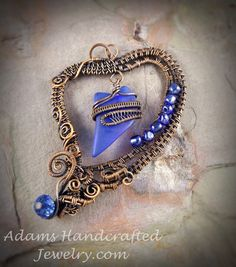 Adams Handcrafted Jewelry. Blue Sea Glass Pendant Wire-wrapped within a Heart Copper Patina Finish.