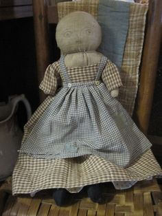 "Fat Hen Farm - Primitive Rag Doll - Early Blue & Brown Homespun...This doll is so special in her brown homespun dress and blue homespun apron.  Her body is made from the most amazing early linen and she has a beautiful old repair on the back of her head. ALso,has sweet black socks. She is completely sewn by hand with early fabric, rag stuffed and super heavy!  Approx. 17 1/2"" tall."