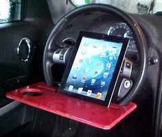 I can see where this could go wrong but i often take work calls while parked and this is clever! Car Steering Wheel iPad Stand Table Laptop by FOLDAWAYFURNITURE, $8.99