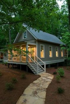Cottage Plans and Exterior Designs for Comfortable Living: Beautiful Rustic Exterior Design Of Cottage Plans With Raised Porch Used Outdoor Staor And Wire Balustrade Also Stone Pathway Idea ~ SFXit Design Villa Inspiration Small Cottages, Cabins And Cottages, Small Cabins, Log Cabins, Rustic Exterior, Exterior Design, Cottage Exterior, Exterior Colors, Exterior Paint