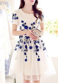 white dress with embroidered blue flowers