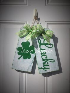 Set of 2 tag signs Lucky and Four leaf clover! Great St. Patricks Day decoration for your front door! They measure 12 x 5.5 each and are hand painted. All signs have a distressed finish. I use all exterior paint, so they can be used inside or out. The come ready to hang with jute and a pretty bow! Please note that because these are hand painted, no two will be exactly alike. Extra items in the picture not included. These signs are great for Valentines Day decorations, Anniversary gifts…