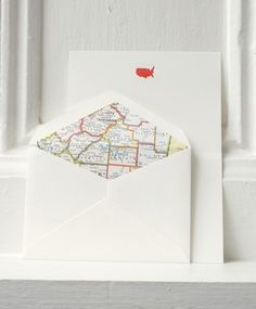 maps inside envelopes via etsy.