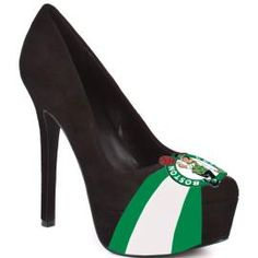 A classic pump with attitude. The Classic by HERSTAR platform pump representing Boston Celtics team colors and logo. This style is available in beautiful, rich shades for top teams of the season. Due to the custom nature of these shoes, please allow 2 weeks for production. •Sizing runs 1/2 - full size small, we suggest ordering a larger size • Easy slip-on wear. • Luscious suede upper. • Almond toe. • Soft man-made lining. • Lightly cushioned man-made footbed. • Wrapped pl...