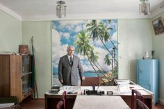 26.7.15 - Azerbaijan Interior. Tropical palm beach mural. Regional Azeri politician in his office.