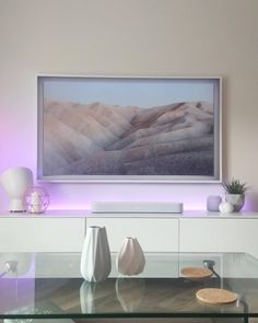 """Our new apartment complete with Philips Hue lights, Sonos Beam and Samsung """"the frame"""" TV in white. Interior Design Mood Board, Hue Philips, Philips Hue Lights, Hue Lights, Frames On Wall, Framed Tv, Beams Living Room, Apartment Inspiration, White Living Room"""