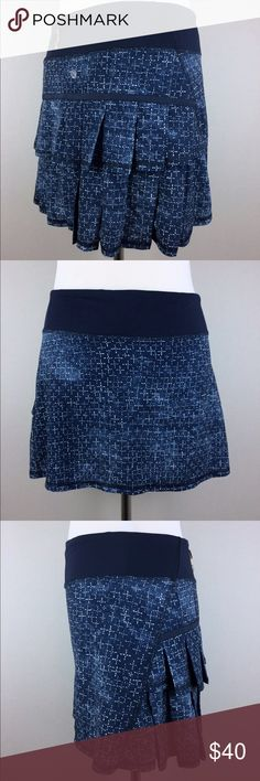 """Lululemon Pace Setter Skirt Sashiko Cross Shorts Brand: Lululemon  Style: Pacesetter Skirt  Size: Women's 4 Tall  Color: Inkwell blue, ghost white  Features: Drawcord waist, pleated back, zip pocket, built in shorts  Preowned. See pictures for details on this Pace Setter skirt by Lululemon. Discontinued and no longer available in stores! Inside tear out tag removed. Please compare measurements for a comfortable fit.  Approximate Measurements:  Back Length: 14""""  Waist (flat): 13""""  Bottom…"""