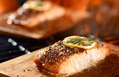 Maple Mustard Glazed Cedar Plank Salmon - Start planning the menu for your next big cottage dinner. Treat your guests to a lighter alternative to traditional cottage BBQ fare. Cedar Plank Salmon, Cedar Grilling Planks, Cedar Planks, Potluck Desserts, Salmon Recipes, Fish Recipes, Cooking Stores, Cooking Hacks, Filet Mignon