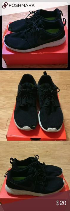 Nike Roshe Run Black Mens Size 10.5 Nike roshe run black pre-owned   Please note these are not in the best shape, there is a small hole in the front of one of the shoes and the pull tags come out easily from the shoe.   Size - US - 10.5  Condition - Used   Please feel free to make offers and view my other listings! Nike Shoes Sneakers