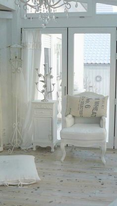 Simply Lovely..love the white chair. just need to add a bright pillow or other pops of color.