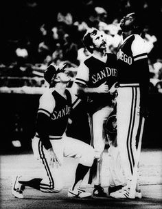 Photographer/Creator  Norman Lono  Collection  1977  Publisher  Philadelphia Daily News  Caption/Description  A member of the San Diego Ball Club tries to pull himself together after being hit in the face by a tip ball off his own bat. Concern is reflected in the faces of two of his fellow players as they come to his aid.