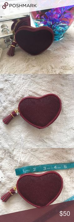 Nieman Marcus Heart Coin Purse Neiman Marcus dyed calf hair coin purse with saffiano leather trim. Tassel Zip around closure. Interior, fabric lining. Wine color with gold tone hardware Reasonable offers will be accepted, no trades. Nieman Marcus Bags