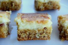 Chess Squares  1(18.25 ounce) package yellow cake mix  1 cup melted butter  1 egg  1 cup chopped pecans    2 (8 ounce) packages cream cheese  4 cups confectioners' sugar  2 eggs
