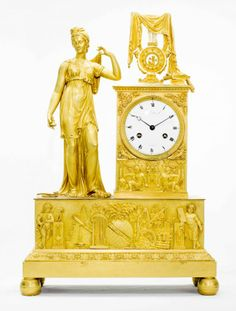 EMPIRE STYLE GILT-BRONZE FIGURAL MANTEL CLOCK  French, 19th Century. The white enamel dial signed 'Malsan & Cie, A. Paris'.