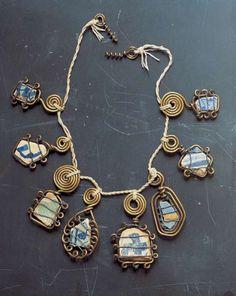 Alexander Calder, necklace, c. 1930, brass wire, ceramic and cord.