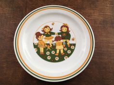aVintage GDR Inglasur Colditz plate Kids retro plate Made in West Germany Scene of Little Girls Playing in Flowers! Colors are dark green, pumpkin yellow and brown on white plate Condition: good cm in diameter White Plates, Yellow And Brown, Little Girls, Germany, Pumpkin, Retro, Tableware, How To Make, Kids