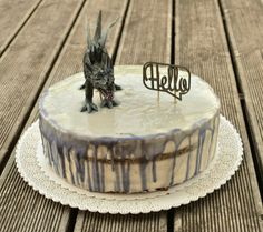 Dragon drip cake Drip Cakes, Camembert Cheese, Dragon, Birthday Cake, Desserts, Food, Tailgate Desserts, Deserts, Birthday Cakes