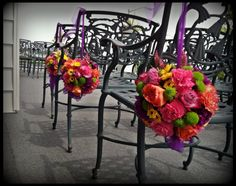 Bright pomander balls for ceremony decor at The Breakers, an oceanfront venue in Spring Lake, NJ. #ChesFloCo